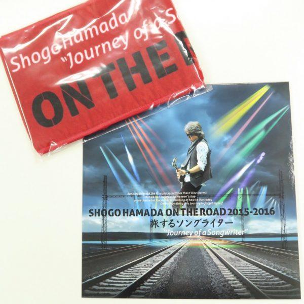 「旅するソングライター」マフラータオルとパンフレット